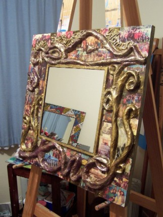 Large Papermache Mirror with embedded photographs of collective group