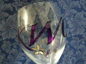 Hand-painted logo onto wine glass.
