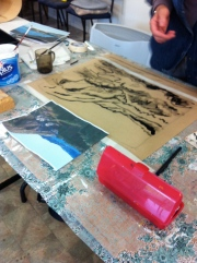 Initial stages of acrylic painting - indian ink on brown paper.