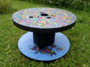 Hand-painted cable reel - unique, colourful and functional.