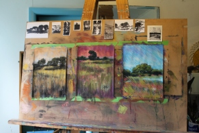 Three completed landscapes in pastel